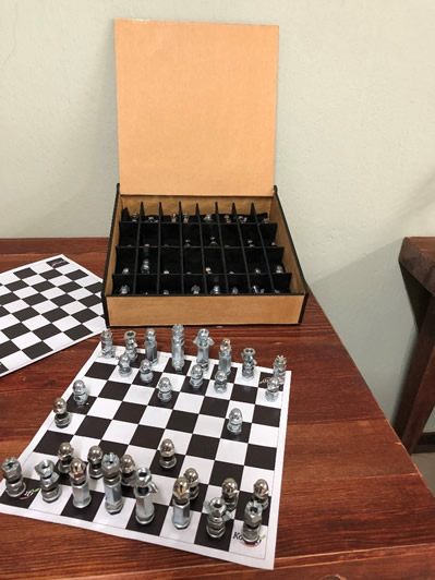 A Chess set made from nuts and bolts, by children of Komati Estate